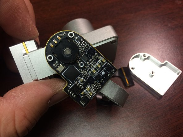 Image 2/3: Next you need to lift the small circuit board up gently out of the yaw arm.