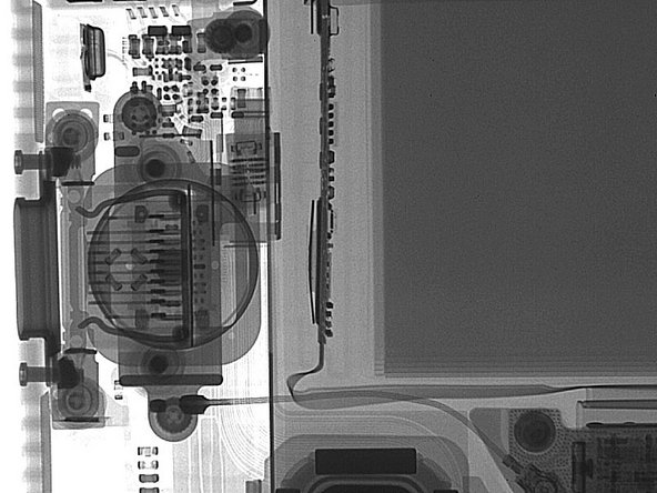 Here's a detail image of the Touch ID sensor. Note that it sits on top of the Lightning connector, that's why you see them overlaid in this x-ray image.