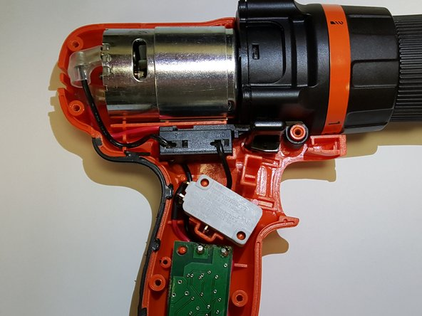 To remove trigger from drill by pulling the mechanism directly up off the the holding pins.