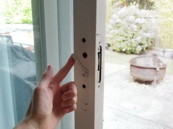 Using the latch key, make sure the key is pointed in the downward position.