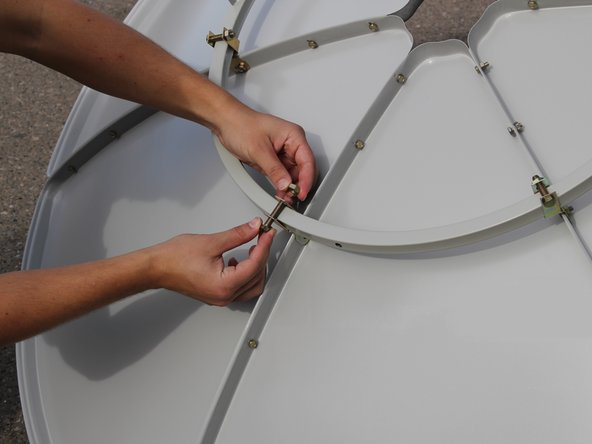 Image 1/2: Tighten using two 14mm wrenches until secure.