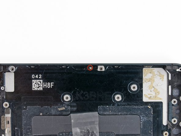 Remove the single 2.0 mm Phillips screw securing the SIM card eject lever to the rear case.
