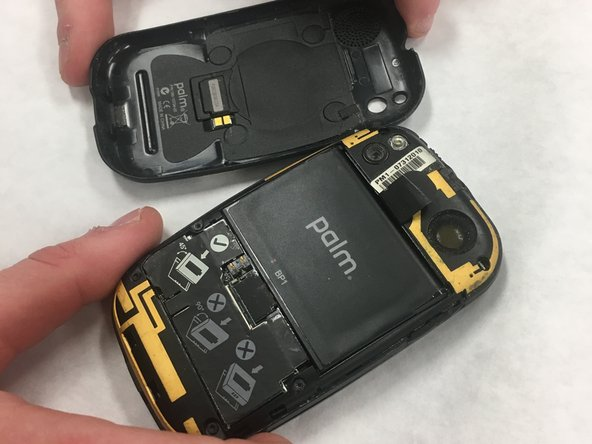 Snap off the back panel to reveal the battery using the opening tool.