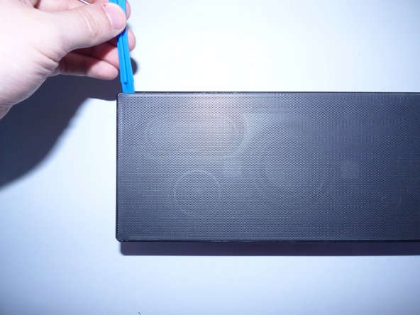 Image 2/2: Repeat the last step on each side of the unit's faceplate, until the faceplate is off.