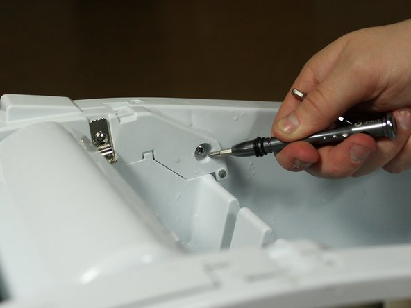Remove the 4 screws holding the Ice Tray from the top.