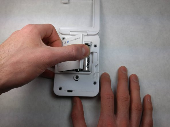 Remove the back plastic cover from the device; this should allow you access to the batteries.