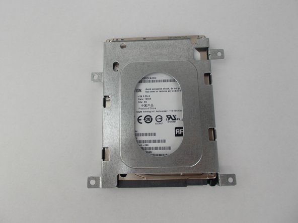 Remove screws from the metal plate enclosing hard drive and enclose replacement hard drive in metal plate.