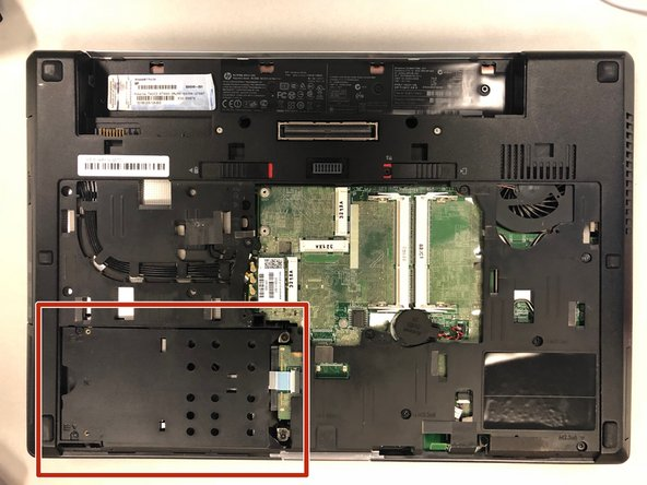 Once the backing has been removed, you will be able to locate the computer's hard drive in the bottom left corner.