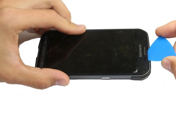 Make sure you pry the display around the edge of the phone. At the bottom of the screen there is a thin metallic strip that connects the display to the motherboard, and it can be easily damaged.