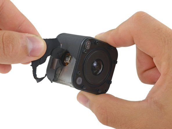 At the top of the camera, the shutter button is integrated into the rubber cover, with a hole in the plastic case underneath exposing the microswitch.