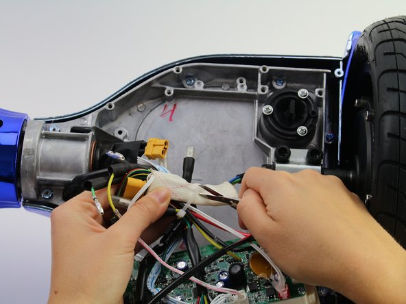 Use scissors to cut the zip tie around the group of wires.
