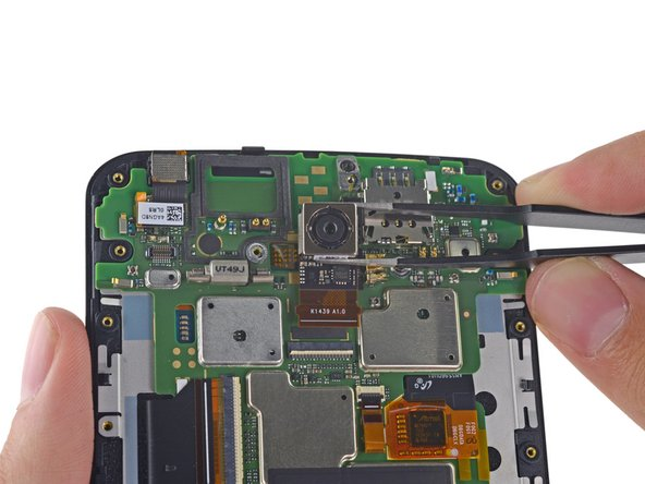 Image 1/3: We easily pluck out the rear- and front-facing cameras with a pair of tweezers.