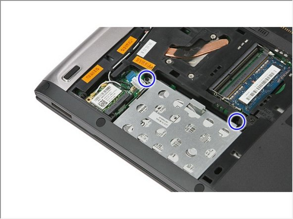 Remove the screws that secure the hard-drive assembly to the computer.