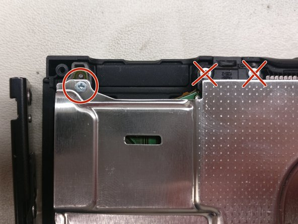 Remove the screws on the back of the metal plate, as indicated by the photos, but don't attempt to pull it off yet.