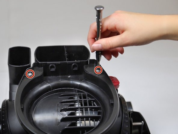 Rotate the motor cover upright until you hear the foot pedal click and the cover won't rotate in either direction.