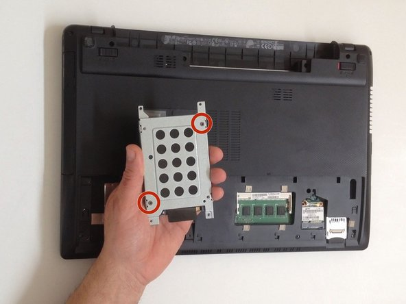 Remove the two Philips screws and separate the HDD from the caddy case.