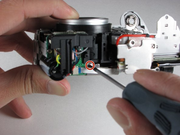 Remove one screw from the top of the camera.
