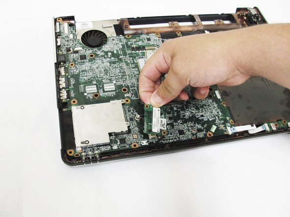 Do not try to remove the modem card from the laptop, it is still attached to the modem connector on the underbody.