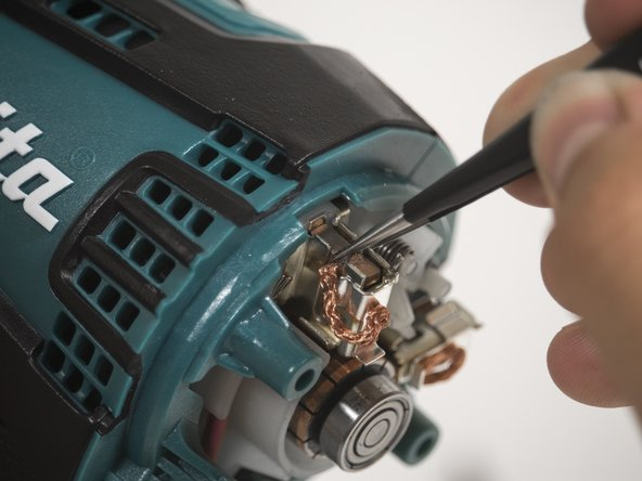 Use the tweezers to pull the drill brush away from the sleeve.
