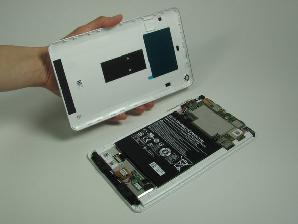 Separate the rear case and place the tablet face side down.