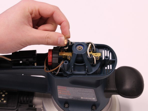 Remove the two white wires connected to each motor brush by pulling on the spade terminals.