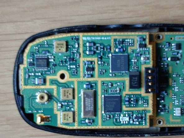 Image 3/3: After removing the screw from the shield, it can be lifted from the board easily, revealing another board beneath it.