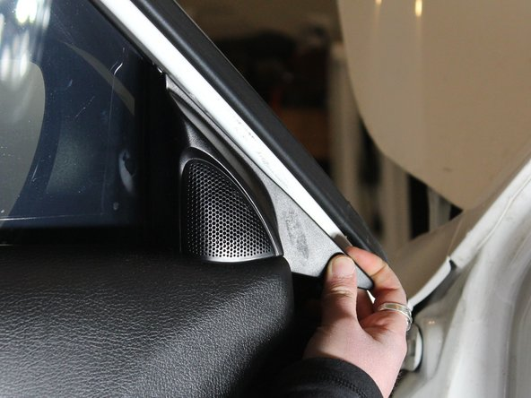 Pop out the cover by the outside mirror to relieve door tension.