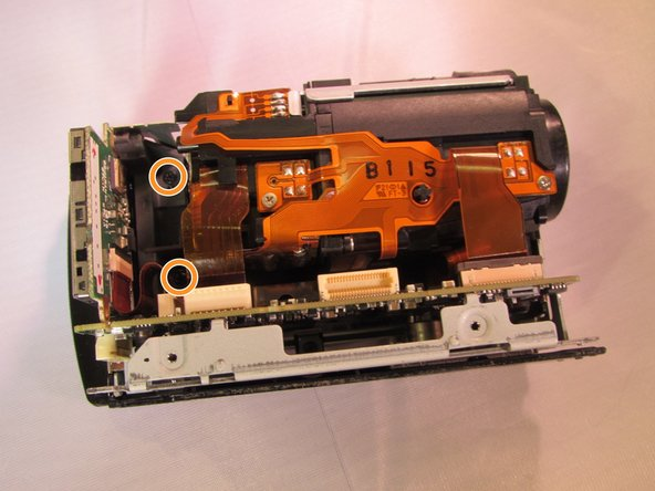 Locate the two black 4 mm screws located on the inside of the device and unscrew them.