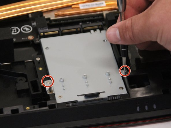 Remove all screws from the back of the hard drive using the Phillips #0 screwdriver, then lift up and unplug the unit. Screws are 0.15625 inches long.