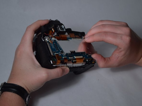 Pull the metal plate off and away from the motherboard.