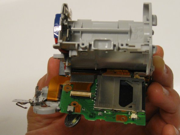 Carefully disconnect the ribbon cable that is attached to the user buttons circuit board away from the ZIF connector that is attached to the motherboard with your thumb and index finger.  Get as close to the ZIF connector as possible without touching the motherboard.