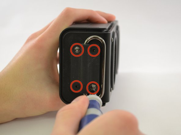Image 1/1: Remove the handle from the device.