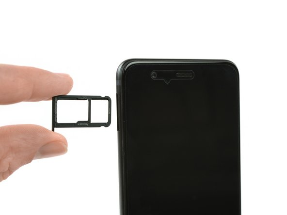 Use SIM card eject tool to remove the SIM card tray.