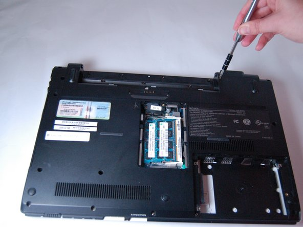 Using a Phillips #0 screwdriver, remove all twelve screws (Length: 7.7 mm) that hold the bottom cover.