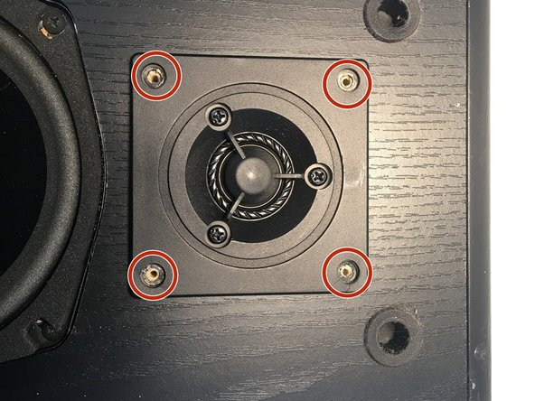 Once the screws have been removed, begin to remove the small upper speaker. To do this, pry it out with either a flateblade screwdriver or sudger.