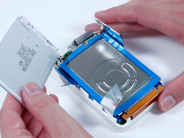 Lift the battery up from the hard drive and lay it next the the iPod (it is still connected to the logic board).