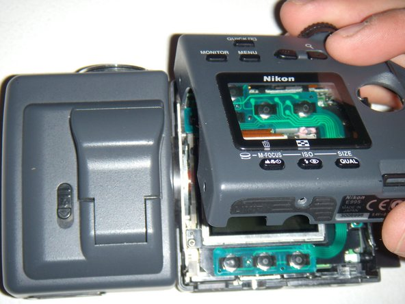 Use your thumb to carefully lift the bottom side of the casing near the battery.