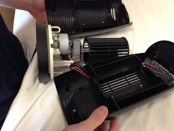 Once you have the fan apart, in order to get more maneuverability, the wire attached to the motor needs to be loosened.  This can be done by removing the two screws highlighted in red.