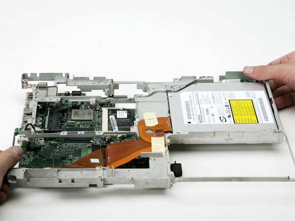 Lift the metal framework up and off the logic board.