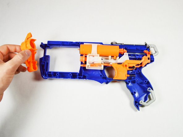 Remove the barrel and the front part of the blaster. The components should simply slide off.