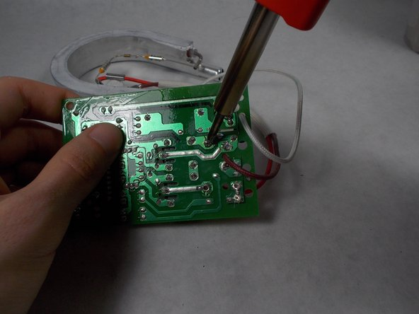 Solder the brown wire connecting the large heating component to the motherboard and remove it.