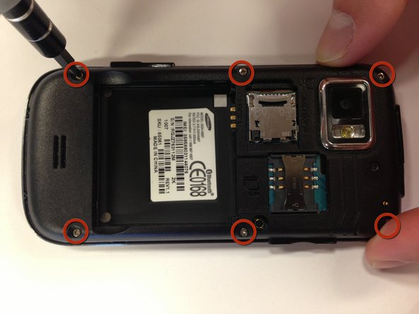 Remove six 5 mm Phillips #0 screws from the back of the phone.