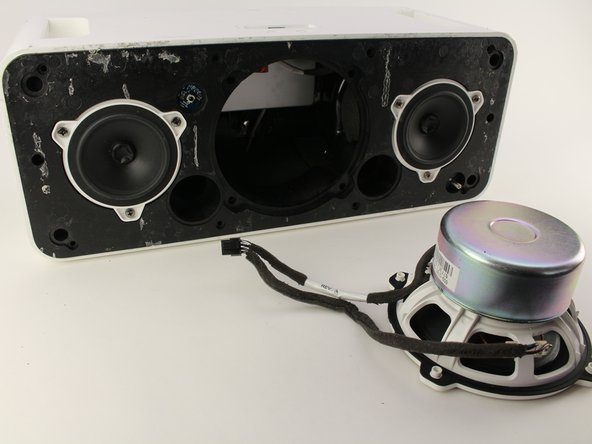 Pull the large speaker completely out and set aside.