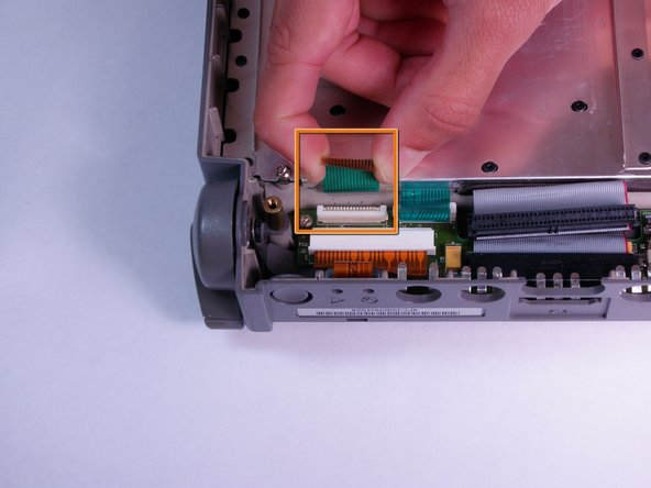Remove the ribbon cable by gently pulling it away from the opened tab fastener.