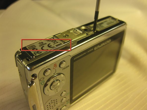 The battery is located on the buttom of the camera.