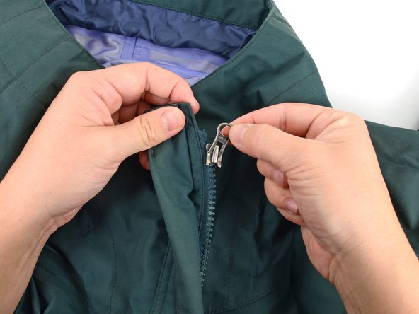 Image 2/3: Make sure the zipper slider is oriented right-side up when you slide it back onto the zipper.