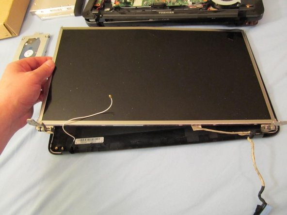 Image 1/2: Now you can remove the LCD panel, along with the hinges.