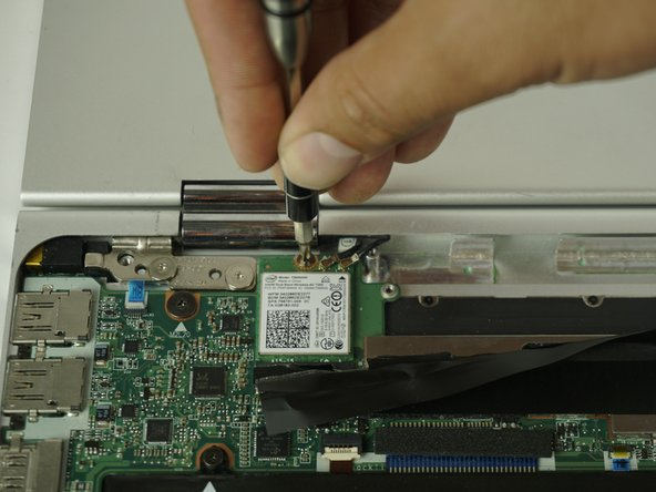 Using the PH00 Screwdriver, Remove the screw that is securing the wireless module.