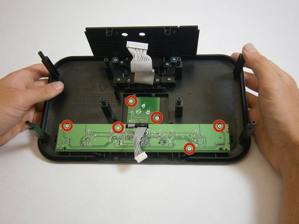 Use a Phillips #000 screwdriver to unscrew six, 5 mm-length 5 mm-head, screws attaching the buttons to the case.