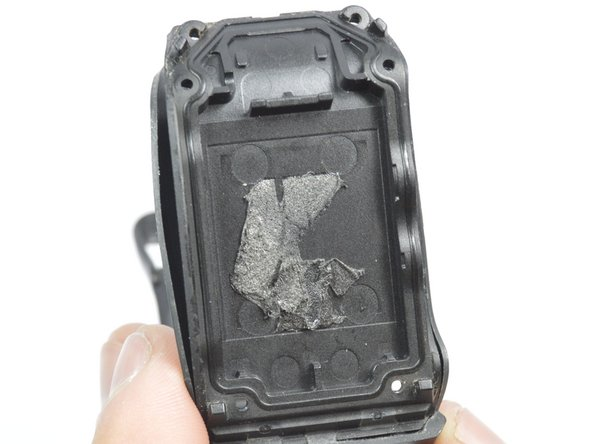 After taking the battery out, you will be left with just the band and the backpanel part of the watch.